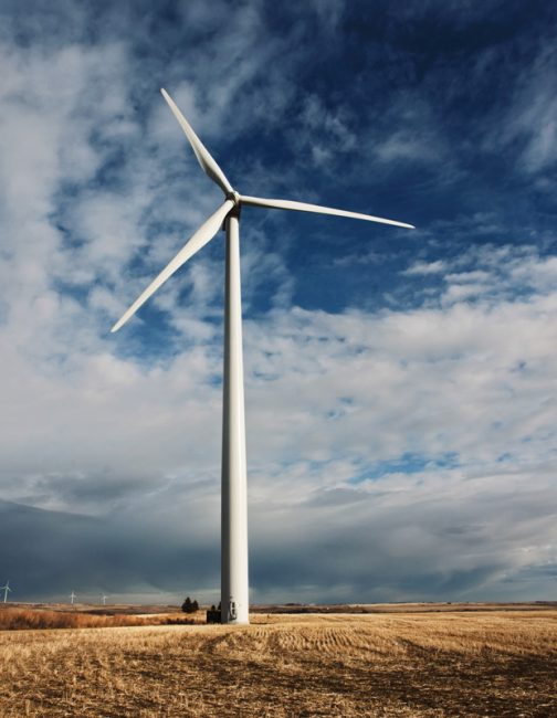 a-single-wind-turbine-tower-in-an-open-space-VEP9D4M
